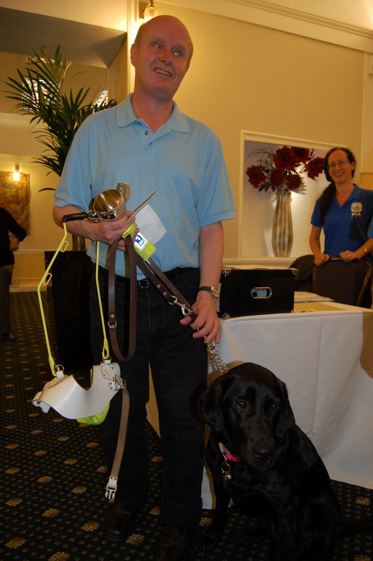 John Gallagher, winner of the Open, with his guide dog Zarah