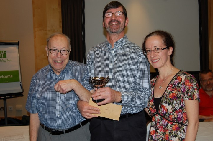 Description: Steve Burnell with his trophy along with Peter Gibbs and Julie Leonard